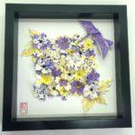 Cadre champs de fleurs en origami et colibri
