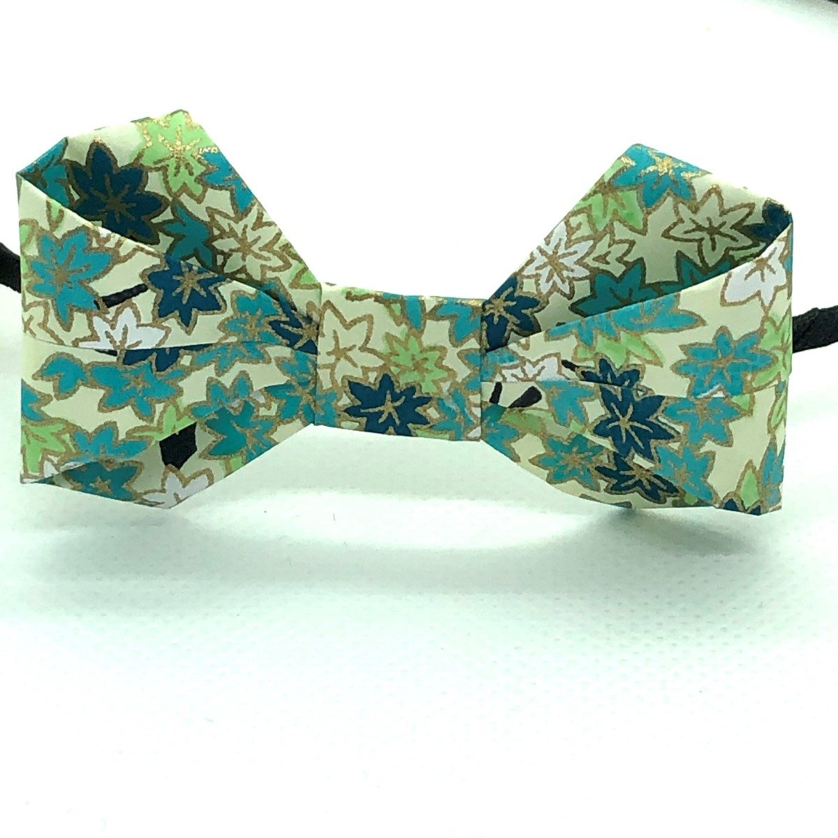 Serre-tête avec nœud en origami bleu turquoise